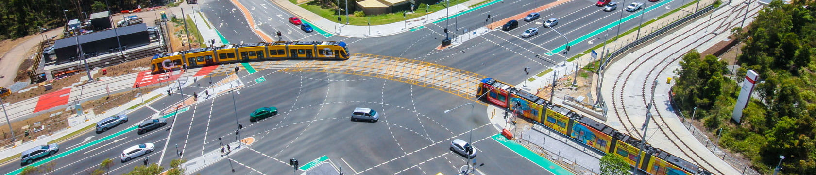 aerial shot of tram going through intersection