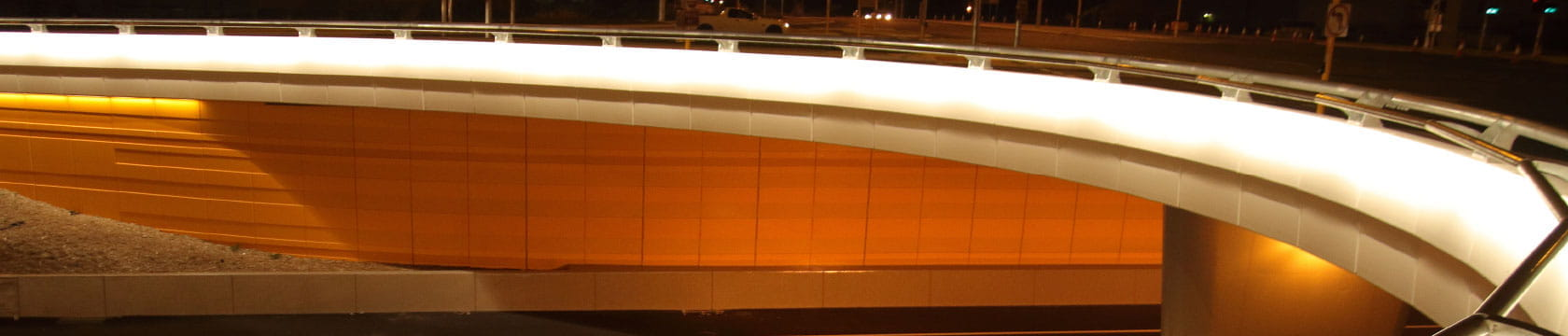 bridge over road at night time