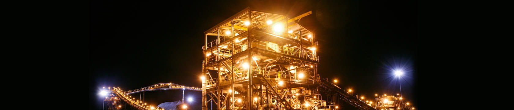 night scene of mineral processing infrastructure