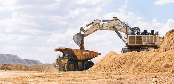 Extraction - Excavator filling dump truck