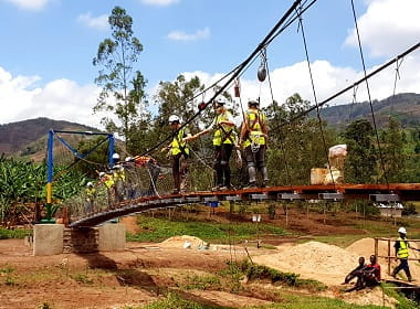 volunteers building a bridge