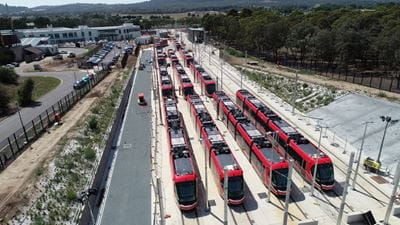 Light rail vehicles lined up photo taken from above